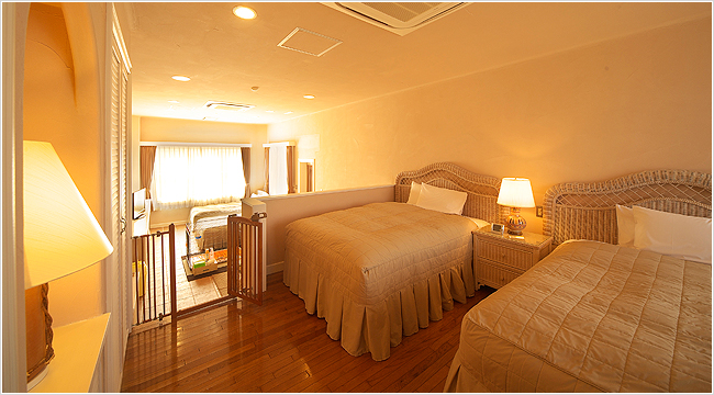 Open style gorgeous quad room is a space where you can enjoy only at the authentic resort hotel.